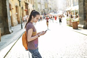 a woman tourist in the center of Prague with a phone in the hands of