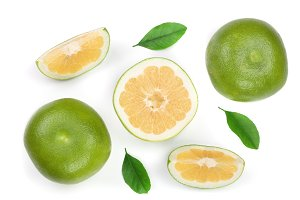 Citrus Sweetie or Pomelit, oroblanco with slices and leaf isolated on white background close-up. Top view. Flat lay