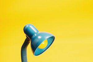 Sky-blue desk lamp on yellow backgro