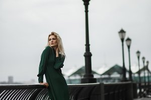 Lady in green dress poses