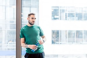 Attractive man with bottle of water