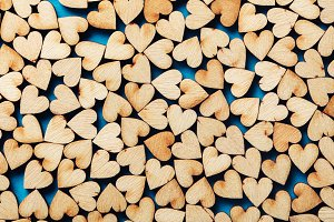 Wooden hearts on blue background.