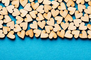Bunch of hearts on blue background.