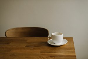 Empty white coffee cup on table