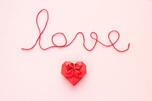Love message with red heart on pink