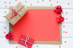 Red paper hearts with gift boxes.