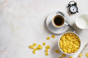Corn flakes, coffee, alarm clock on