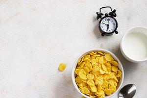 Corn flakes, coffee, alarm clock on