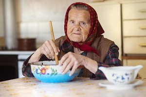 Old woman at home.