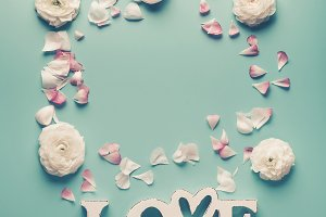 Word LOVE with pastel flowers