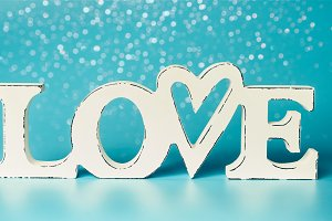 LOVE on turquoise blue background
