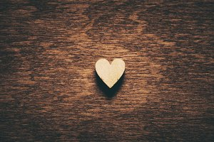 Heart on dark wooden background