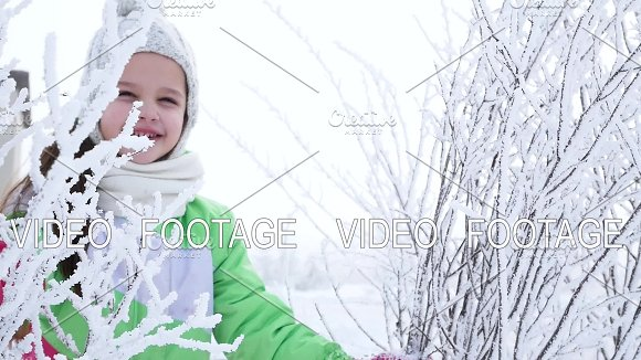 Girl Shakes The Snow From The Tree Branch In The Forest Happy Childhood Winter Fun