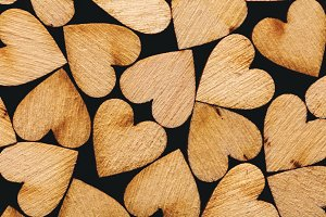 Wooden hearts laying together tightl