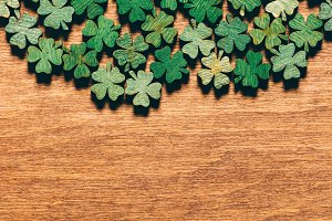 Wooden green shamrocks laying on the