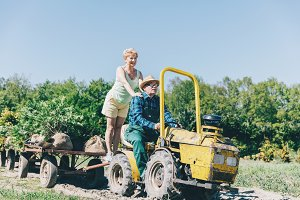 Older couple riding on tractor trail