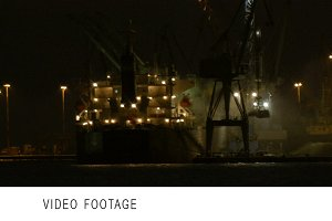 Unloading cargo ship at night 2
