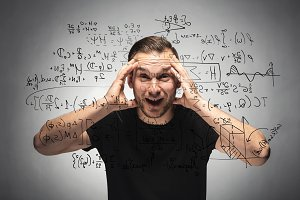 Shocked man looking at equation