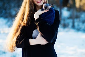 Beautiful young girl with cat breed