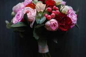 Beautiful wedding bouquet on a dark