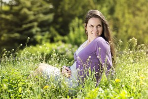 Pregnant woman in the nature.