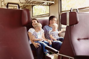 Family travelling by train.