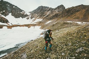Hiker girl in mountains Traveling