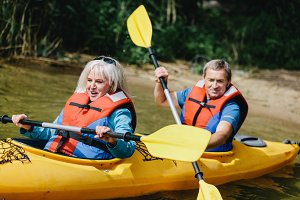 Elderly marriage rowing in the kayak