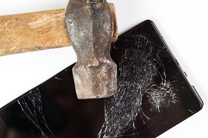 An old hammer and smartphone