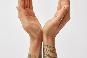 hands of girl with tattoo open