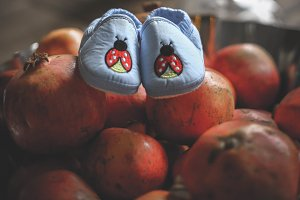 little baby shoes and  pomegranate
