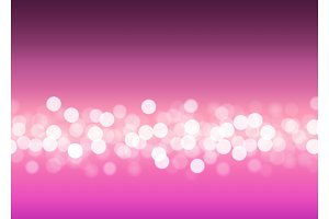 Abstract bokeh lights on pink background