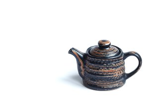 isolated clay teapot on white background.