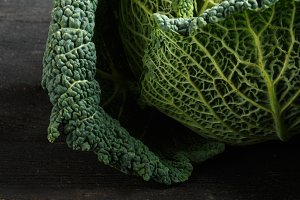 Savoy cabbage on a dark wooden table