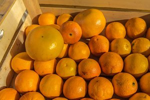 Fresh oranges in a wood box