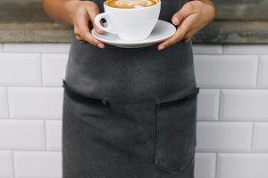 Unrecognizable woman wearing apron