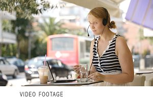 Laughing woman wearing a headset