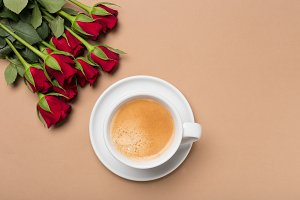 Red roses and cup of coffee