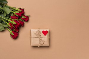 Red roses and gift with heart sign