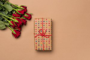 Red roses and gift wrapped in hearts