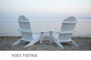 Empty wooden deck chairs on a beach