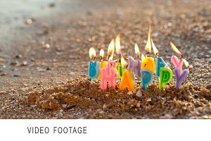 Birthday candles burning seashore