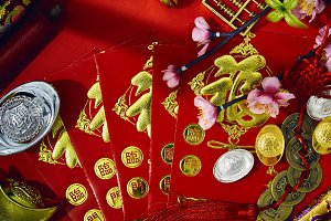 Plum blossom with red envelope and r