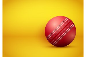 Cricket ball on bright orange background