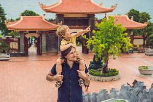 Happy tourists dad and son in Pagoda. Travel to Asia concept. Traveling with a baby concept