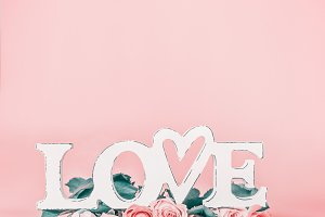 Pastel pink background with Love