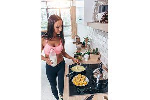 Young smiling woman preparing healthy breakfast. Diet, fitness and vitality.