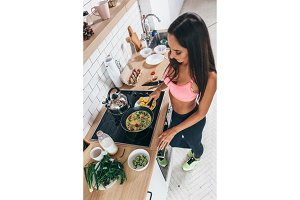 Fit woman preparing low carb meal in the kitchen Top view