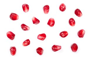 pomegranate seeds isolated on white background. Top view. Flat lay pattern