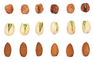Mix nuts almonds, hazelnuts pistachios isolated on white background. Top view. Flat lay
